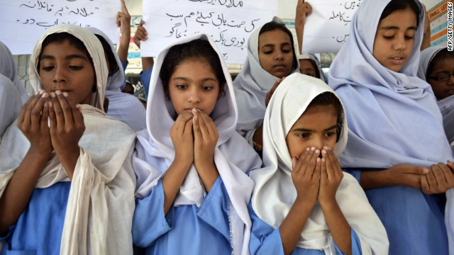 "Pakistani school girls pray for the Malala's recovery on Wednesday. Over the weekend, the teen moved her limbs after doctors ""reduced sedation to make a clinical assessment,"" military spokesman Maj. Gen. Asim Bajwa said."