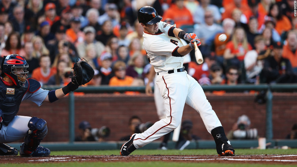 Buster Posey of the San Francisco Giants flies out in the first inning against the St. Louis Cardinals during Game One of the National League Championship Series at AT&T Park in San Francisco on Sunday, October 14. The winner of the seven-game series will advance to the 2012 World Series.