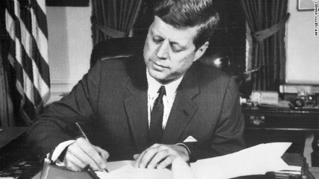 President John F. Kennedy signs the order of naval blockade of Cuba on October 24, 1962.