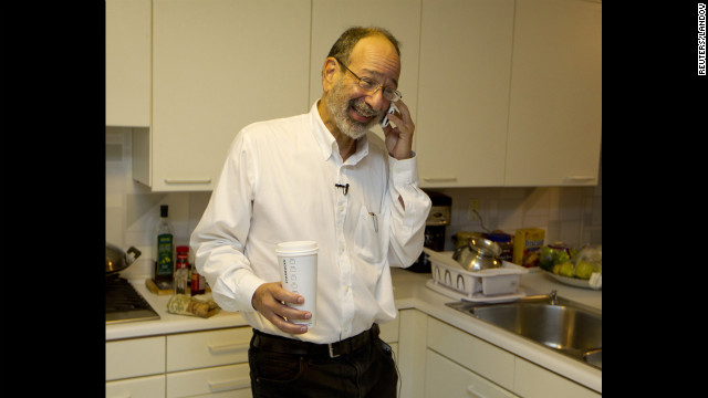 Alvin Roth receives congratulatory phone calls at his home in Menlo Park, California, on Monday, October 15, after winning the Nobel Memorial Prize in Economics, which he shared with Lloyd Shapley. Roth was &quot;surprised&quot; and &quot;delighted&quot; when he got the midnight call at his California home telling him he had won.