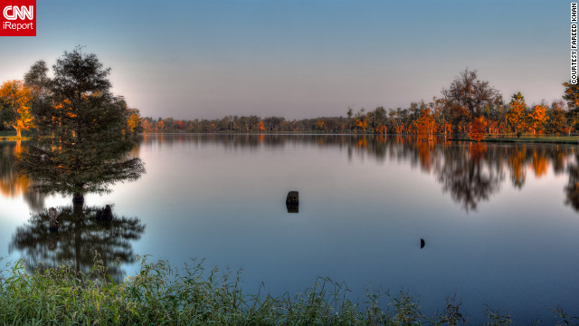 <a href='http://ireport.cnn.com/docs/DOC-853145'>Jacobson Park Reservoir</a> reflects the fall trees around its smooth surface.