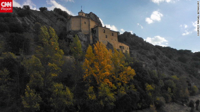 Fall leaves highlight a 13th-century church perched on a cliff in &lt;a href='http://ireport.cnn.com/docs/DOC-853517'&gt;Soria, Spain&lt;/a&gt;.