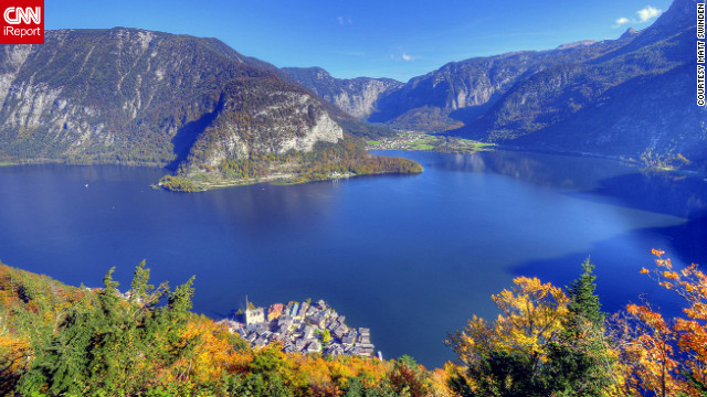 Colorful trees show up beautifully against the blue waters of <a href='http://ireport.cnn.com/docs/DOC-858548'>Hallstatt, Austria</a>.