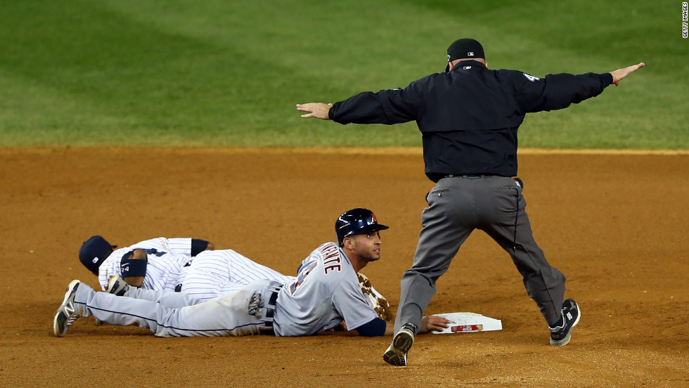 Umpire Jeff Nelson calls Omar Infante of the Detroit Tigers safe at second base despite the efforts of Robinson Cano of the New York Yankees in the top of the eighth inning on Sunday, October 14. The Tigers defeated the Yankees 3-0 in the second game of the American League Championship Series at Yankee Stadium, taking a 2-0 lead in the series.