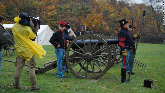 The cannon is readied by Union Artillery soldiers as the camera looks on