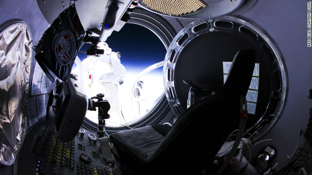 Felix Baumgartner of Austria jumps out of the capsule during the final Red Bull Stratos flight on Sunday, October 14. Baumgartner ascended steadily in a capsule hanging from a helium balloon before jumping from 128,000 feet -- 24 miles up -- with nothing but a space suit, helmet and parachute.