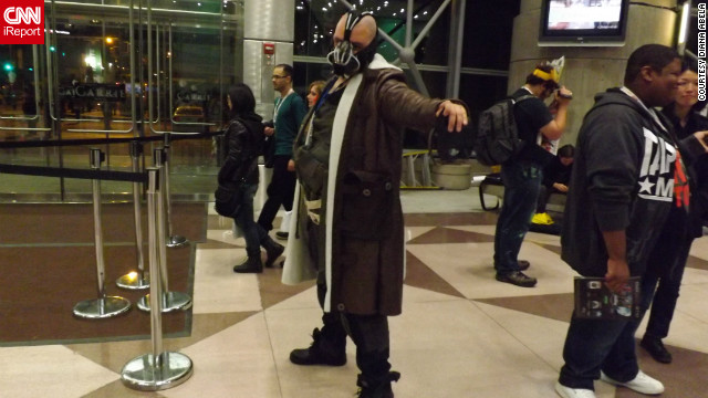 "Don't worry, Bane's not robbing a bank here. But fans dressed as the ""Dark Knight Rises"" character were seen in many of the iReport photos from New York Comic Con.<br/><br/><a href='http://ireport.cnn.com/docs/DOC-857175' target='_blank'>See the full collection of photos on Diane Abela's iReport</a>."