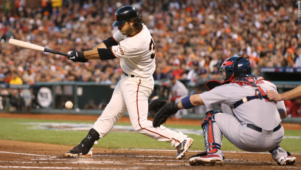 Brandon Crawford of the San Francisco Giants hits a scoring a run in the fourth inning of Game Two of the National League Championship Series against the St. Louis Cardinals at AT&amp;amp;T Park in San Francisco on Monday, October 15. The winner of the seven-game series will advance to the 2012 World Series. &lt;a href='http://www.cnn.com/2012/10/14/worldsport/gallery/nlcs/index.html'&gt;Look back at Game One of the NLCS.&lt;/a&gt;