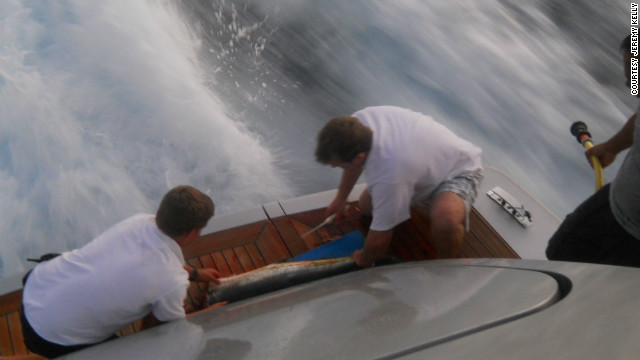 Chef Jeremy Kelly, right, cleans a fish caught in French Polynesia in preparation for an evening meal. &quot;You can be the best chef in the world, but without organization you're going to crash and burn,&quot; he says.