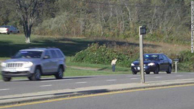 Lane Snow, age 9, salutes the funeral procession of Virginia State Police trooper Andrew Fox, in this Facebook photo.