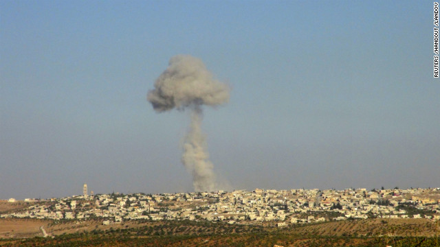 Smoke rises after a Syrian Air Force fighter jet fired missiles at the suburbs of the northern province of Idlib on October 16.