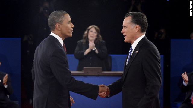 President Obama and Republican presidential candidate Romney shake hands before the start of the debate.
