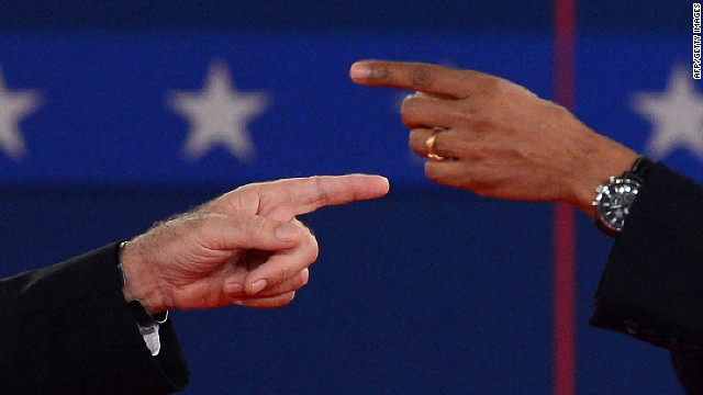 U.S. President Barack Obama and Republican presidential candidate Mitt Romney point fingers at each other.