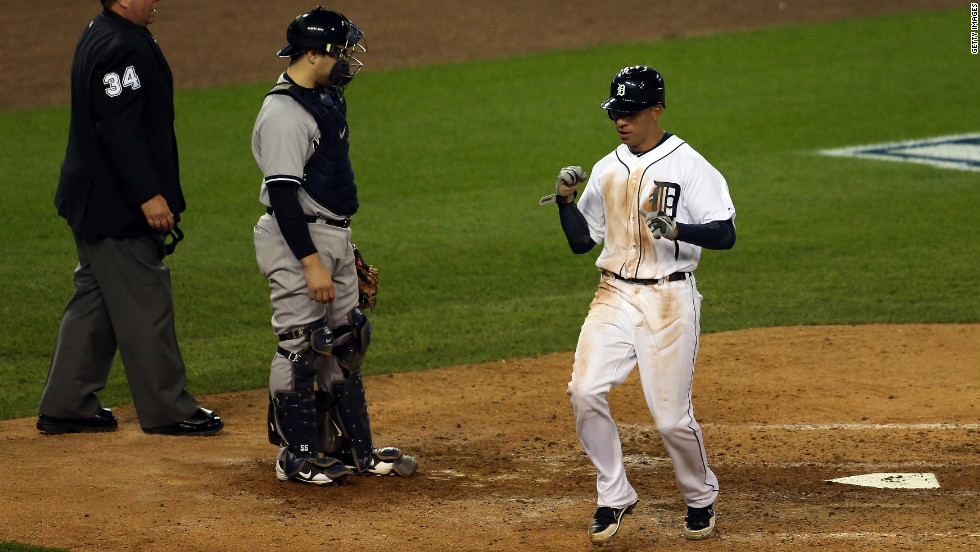 Quintin Berry of the Detroit Tigers reacts after scoring on a RBI double by Miguel Cabrera in the bottom of the fifth inning against the New York Yankees during Game 3 of the American League Championship Series at Comerica Park on Tuesday, October 16, in Detroit, Michigan. The Tigers lead the Yankees 2-0 in the playoff series.