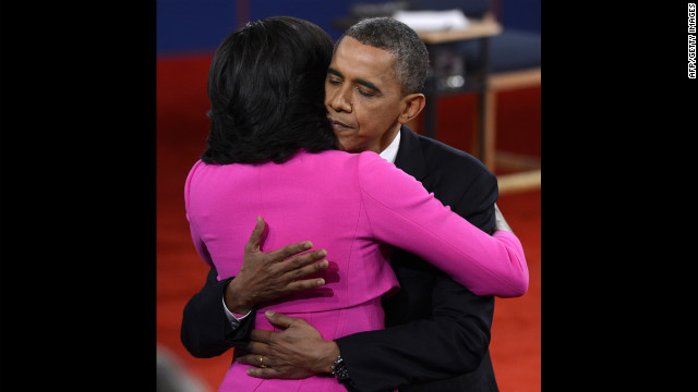 President Obama and first lady Michelle Obama embrace after the debate.