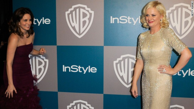 Fey snuck up on Poehler while she was smiling for the cameras at InStyle's Golden Globes after party in 2012.