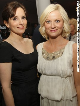 Tina Fey spent the 2012 Golden Globes photo bombing her pal Amy Poehler, but she won't be lurking in the background at the 2013 awards show. Fey and Poehler, who've made us laugh in &quot;Saturday Night Live,&quot; 2008's &quot;Baby Mama,&quot; and their respective NBC sitcoms, &quot;30 Rock&quot; and &quot;Parks and Recreation,&quot; will host the Golden Globes together on January 13, 2013.
