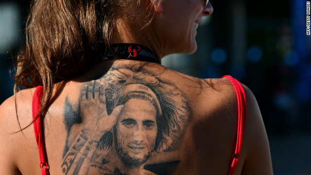 As MotoGP returns to Malaysia for the first time since the tragic death of Marco Simoncelli, the Italian's memory is very much to the fore of the sport. Here, a fan of the rider, shows her devotion with a tattoo in tribute to her hero who died following a fatal crash on October 23 2011.<br/><br/>