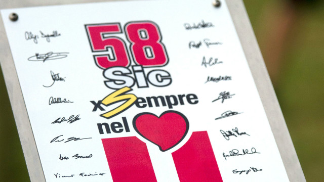 The whole of the MotoGP world stopped in silence at the unveiling of a plaque in memory of the Italian during the ''Tribute for Marco Simoncelli' ahead of the race in Malaysia. The number '58' which was Simoncelli's number and his nickname 'Sic' are both included on the memorial.<br/><br/>