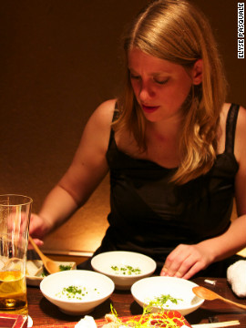 Here she gets to grip with three different types of Tofu at a restaurant in Tokyo, Japan.