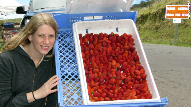 Elyse Pasquale poses with fresh strawberries in the shadow of the Poas Volcano, Costa Rica. &quot;Food is an entirely sensory experience. You can touch it, you can smell it, you can taste it. What better way is there to learn about a place you've never been before,&quot; she asks.
