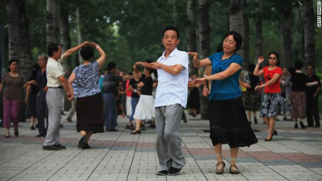 Beijing residents practice ballroom dancing in a park in Beijing, China.