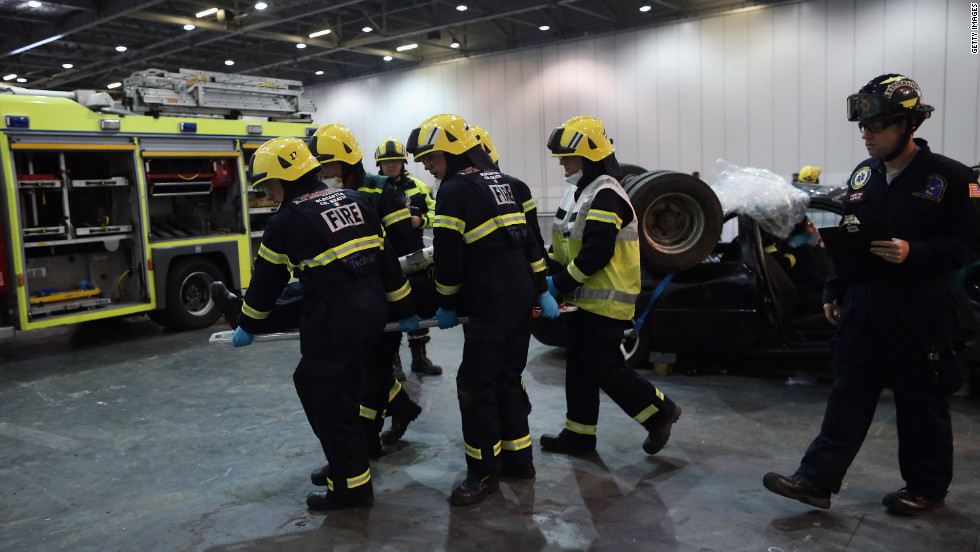 Members of the Fire Brigade participate in an extrication and trauma challenge during the <a href='http://www.wrescue.org/uk/rescue_challenges/' target='_blank'>World Rescue Challenge</a> at the Excel Center on Thursday, October 18, in London. Firefighters from across the world are currently competing in the annual contest. The challenges consist of a series of emergency rescue scenarios and is the largest fire and rescue service challenge in the world. The contest ends October 20.