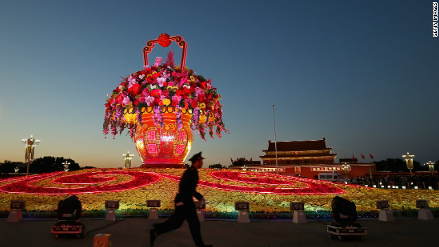 A giant flower looms over Tiananmen Square as Beijing prepares for China's once-in-a-decade leadership change.