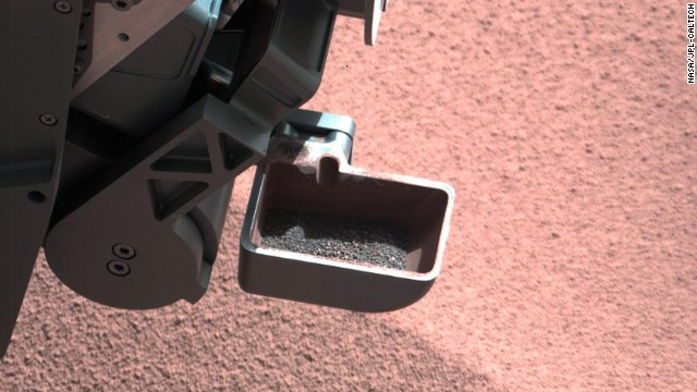 The rover's scoop contains larger soil particles that were too big to filter through a sample-processing sieve. After a full-scoop sample had been vibrated over the sieve, this portion was returned to the scoop for inspection by the rover's mast camera.