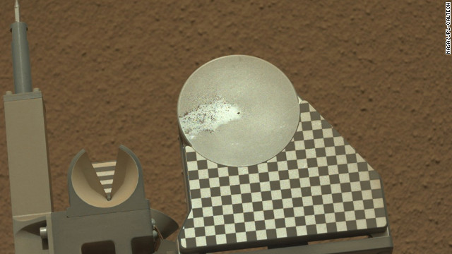 The robotic arm on NASA's Mars rover Curiosity delivered a sample of Martian soil to the rover's observation tray for the first time on October 16.