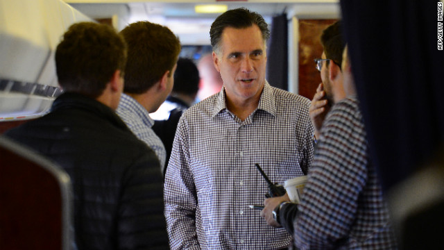 Romney speaks with campaign staff on board his campaign plane at Washington Dulles International Airport in Chantilly, Virginia, on Thursday, October 18.