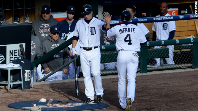Omar Infante of the Detroit Tigers scores on a RBI single hit by Delmon Young in the first inning.