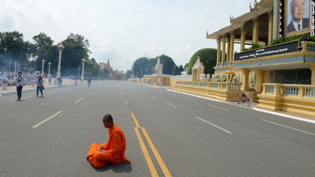 A Cambodian Buddhist monk prays for King Norodom Sihanouk in front of the royal palace in Phnom Penh on Thursday, October 18. Sihanouk, the former king, died of natural causes at age 89 on Monday. Experts in Cambodia began preparations on Thursday to embalm Sihanouk, who will lie in state at the royal palace for three months ahead of a lavish funeral, a royal aide said.