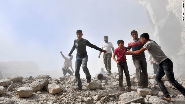 Syria youths react following an airstrike by Syrian government forces in Maaret al-Numan on Thursday, October 18. Syrian regime warplanes launched a new wave of strikes on the northwestern town, seized by rebels last week, an AFP correspondent reported.