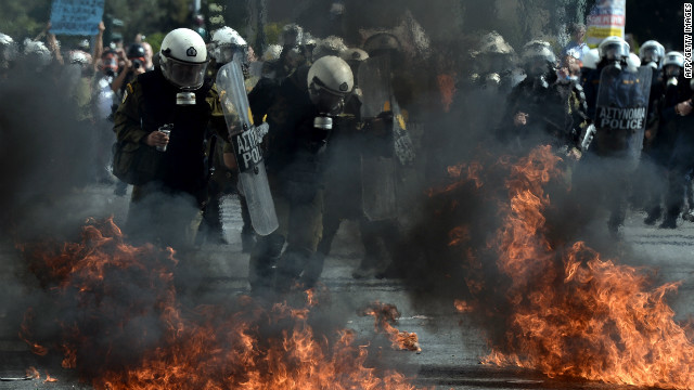 Riot police clash with demonstrators at an anti-austerity rally in Athens on October 18, 2012. The rally took place as workers across the country went on a 24-hour strike and EU leaders met to discuss the eurozone crisis.