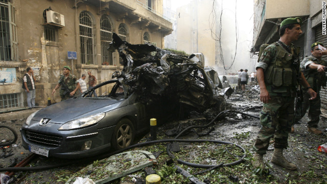 Lebanese soldiers secure the area around the mangled wreckage of the blast.