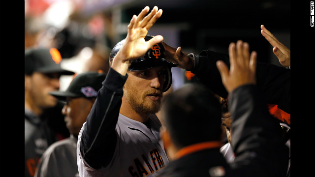 Hunter Pence of the San Francisco Giants is congratulated in the dugout after hitting a solo home run in the second inning.