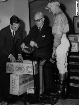 Australian jockey Scobie Breasley's weight is measured in sultanas in 1959. Riders must follow strict low-calorie diets to keep their weight down.