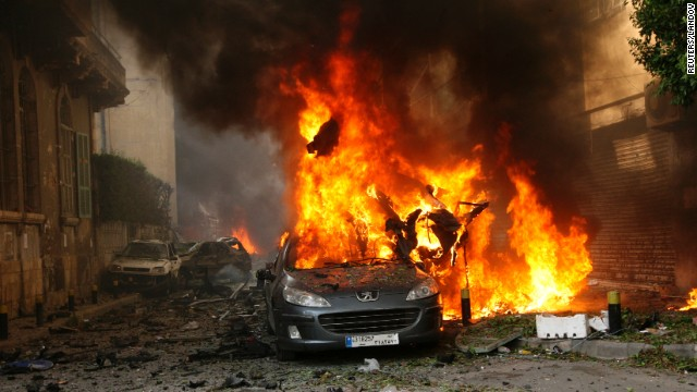 A car burns after an explosion in Beirut's predominantly Christian district of Ashrafiyeh. 