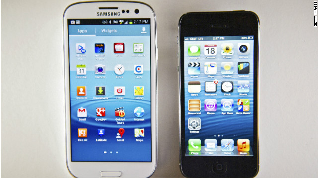 The Samsung Galaxy S III smartphone, left, beside its new rival, the iPhone 5.