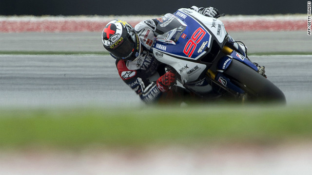 Spain's Jorge Lorenzo beat Valentino Rossi's lap record at the Sepang International Circuit in qualifying.