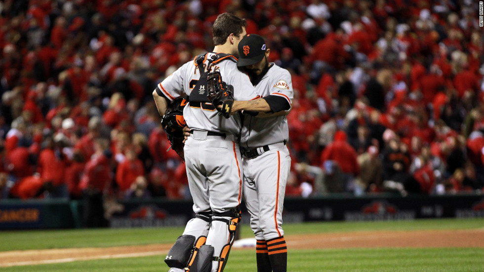 No.28 Catcher Buster Posey and No. 54 Sergio Romo of the San Francisco Giants celebrate the Giants 5-0 victory over the St. Louis Cardinals in Game 5 of the National League Championship Series at Busch Stadium on October 19, 2012, in St. Louis, Missouri. <a href='http://www.cnn.com/2012/10/18/worldsport/gallery/nlcs-game-4/index.html'>Look back at Game 4 of the NLCS</a>.