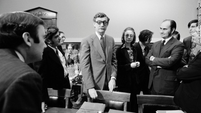 Hillary Rodham, center, a lawyer for the Rodino Committee, and John Doar, left, chief counsel for the committee, bring impeachment charges against President Richard Nixon in the Judiciary Committee hearing room at the U.S. Capitol in 1974.