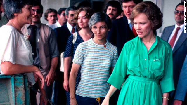 Arkansas Gov. Bill Clinton helps first lady Rosalynn Carter on a campaign swing through Arkansas in June 1979. Also seen in the photo is Hillary Clinton, center background.