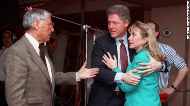 "Bill Clinton embraces his wife shortly after a stage light fell near her on January 26, 1992. They talk to Don Hewitt, producer of the CBS newsmagazine ""60 Minutes."""