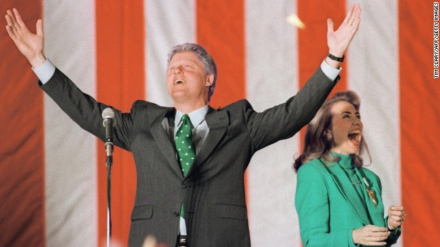 With Hillary, Democratic presidential candidate Bill Clinton waves to the crowd during his victory party after winning the Illinois primary on March 17, 1992.