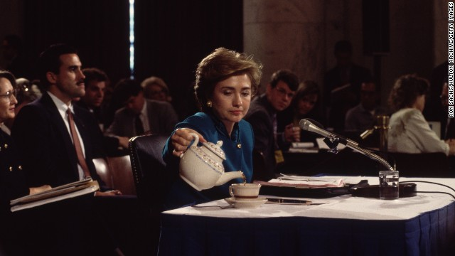 Clinton pours herself a cup of tea in 1993 while testifying to the Senate Education and Labor Committee about health care reform.
