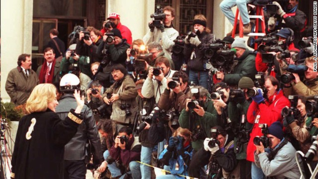Clinton waves to the media on January 26, 1996, as she arrives at federal court in Washington for an appearance before a grand jury. The first lady was subpoenaed to testify as a witness in the investigation of the Whitewater land deal in Arkansas.