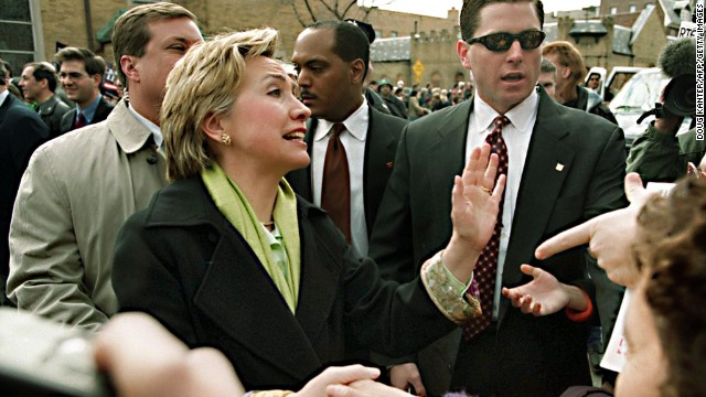 Clinton shakes hands during a St. Patrick's Day parade in the Sunnyside neighborhood of Queens, New York, on March 5, 2000.
