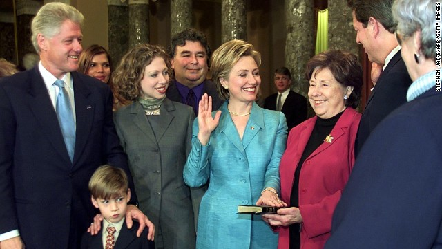 First lady Hillary Clinton is sworn in as a senator in a reenactment ceremony with President Bill Clinton, from left, nephew Tyler, daughter Chelsea, brother Hugh Rodham, mother Dorothy Rodham and Vice President Al Gore in the Old Senate Chamber on Capitol Hill on January 3, 2001, in Washington.